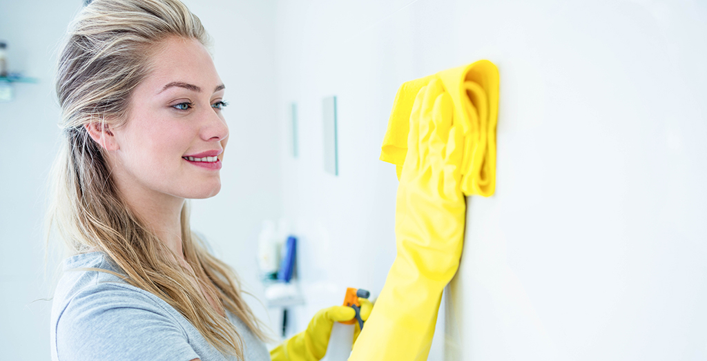 Woman cleaning with gloves on